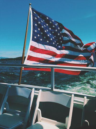 American flag on boat railing