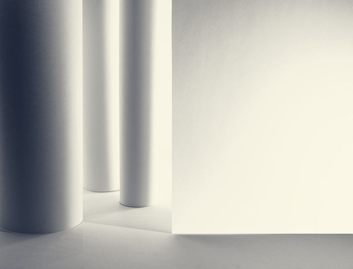 Close-up of white curtain against wall