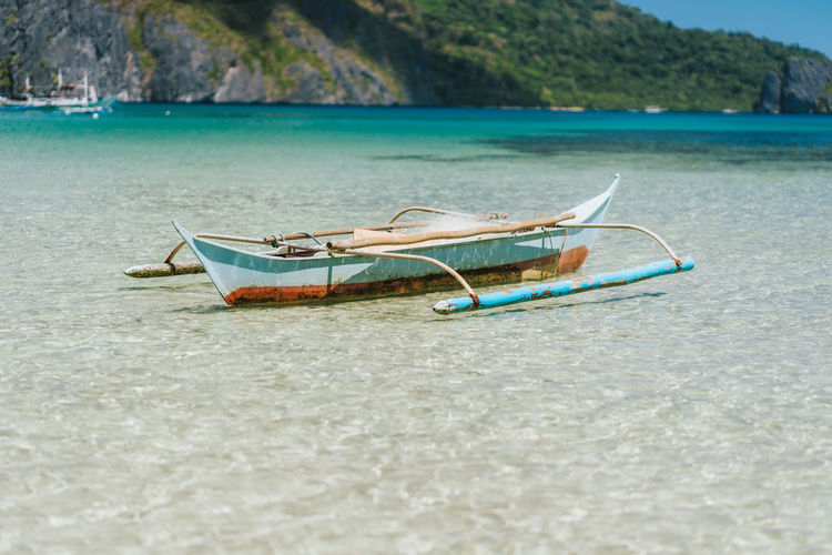 Boat moored on shore