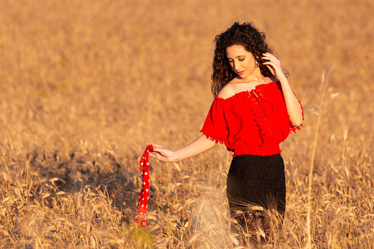 Woman standing in a field
