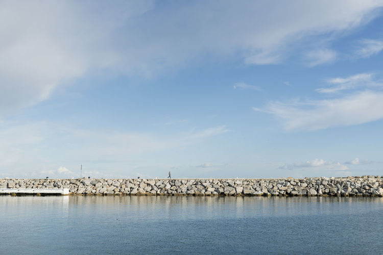 Puerto Banus SPAIN Minimal Minimalism Water Sky Cloud - Sky Sea Waterfront Scenics - Nature Beauty In Nature Tranquility No People Day Tranquil Scene Nature Non-urban Scene Outdoors Idyllic Blue Groyne Strideby One Person One Person Walking Harbor
