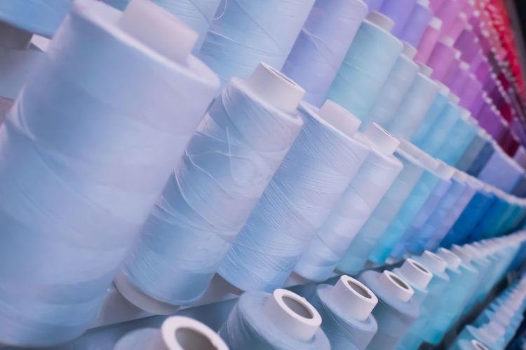 Full frame shot of multi colored thread spools