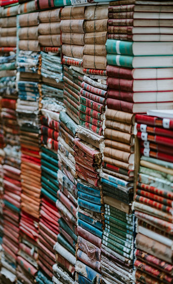Piles of old, worn books Abundance Arrangement Backgrounds Book Book Spines Choice Close-up Collection Focus On Foreground For Sale Full Frame In A Row Indoors  Large Group Of Objects Literacy Literature Multi Colored No People Order Retail  Selective Focus Stack Still Life Variation