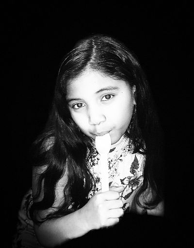 Portrait of a girl in black background