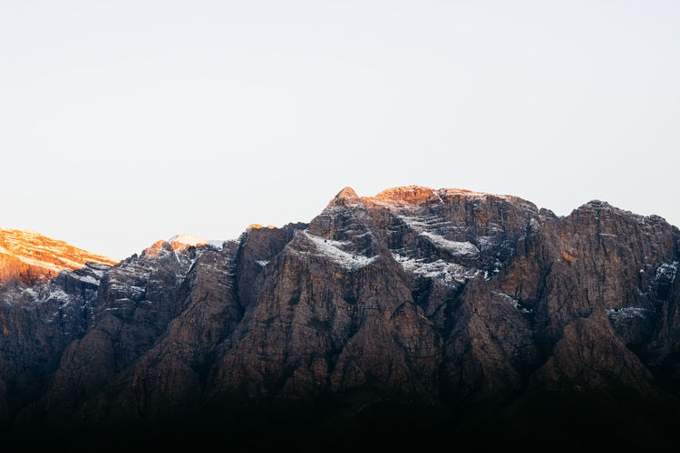Morning light in Slanghoek. Morning glimmer on the peaks of the mountains in the southern Western Cape, South Africa. Early July, 2018. Cape Town Exploring South Africa The Great Outdoors - 2018 EyeEm Awards The Traveler - 2018 EyeEm Awards Travel Beauty In Nature Ceres Clear Sky Copy Space Jonnynichayes Landscape Mountain Mountain Peak Mountain Range Nature Outdoors Rock Rock Formation Rocky Mountains Scenics - Nature Sky Snow Snowcapped Mountain Tranquil Scene