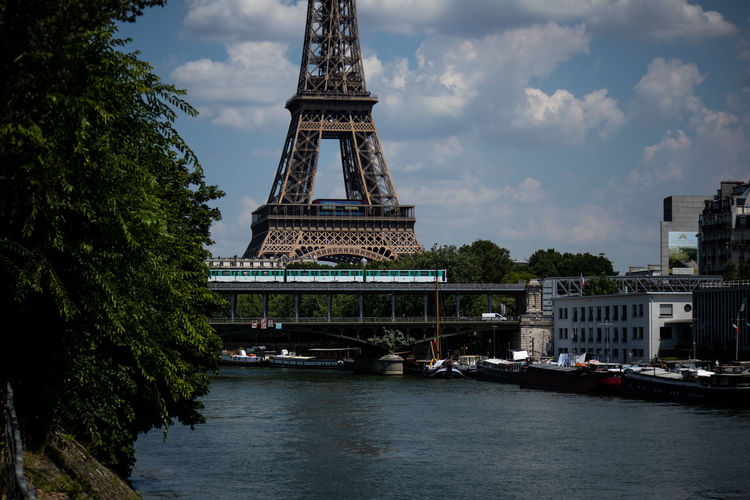 Eiffel Tower Metro Architecture Building Exterior Built Structure City Cloud - Sky Eiffel Mode Of Transportation Nautical Vessel No People Outdoors Passenger Craft Plant River Sky Tourism Tower Transportation Travel Travel Destinations Tree Water Waterfront