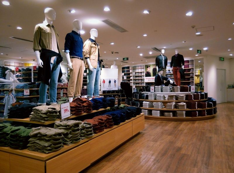 Indoors  Retail  Large Group Of Objects Person Variation Reflection Occupation Abundance Collection Choice Freshness Clothes Clothes Shopping Clothes Store Store Colorful Warm Atmosphere Neat