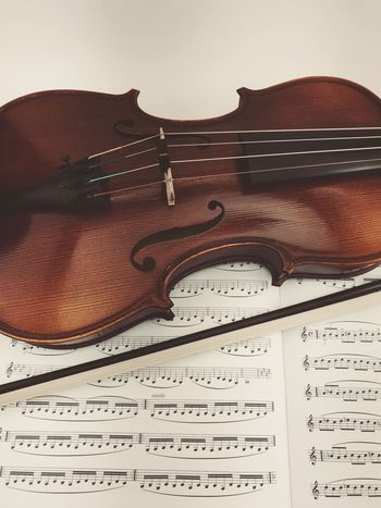 violin and practice book Music Practice Music String Instrument Musical Instrument Musical Equipment Indoors  No People Close-up Arts Culture And Entertainment Paper Sheet Music Musical Note Still Life Violin Musical Instrument String Classical Music String