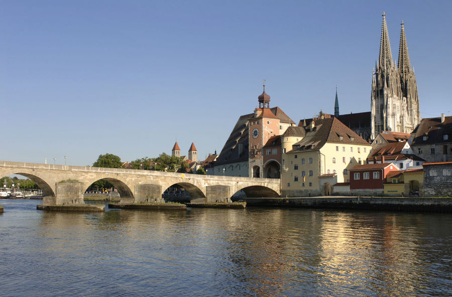 old stone bridge over Danube river with cathedral in city Regensburg, Bavaria Bavaria Cathedral City Cityscape Danube Regensburg Water Reflections Architecture Bridge - Man Made Structure Building Exterior Built Structure Clear Sky Danube River Medieval No People Old Stone Bridge Outdoors Religion River Scenics Spirituality Stone Bridge Travel Destinations Water Waterfront