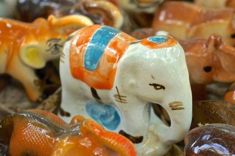 Close-up of elephant figurines at market