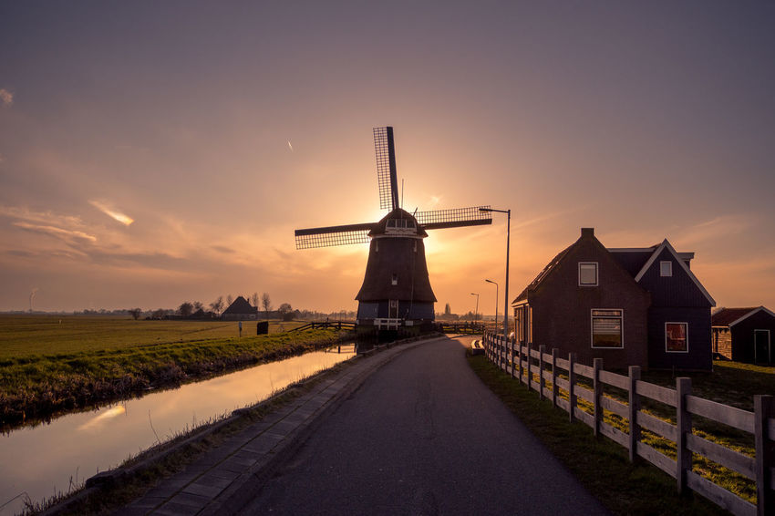 Alternative Energy Architecture Building Exterior Built Structure Environment Environmental Conservation Fuel And Power Generation Land Landscape Nature No People Orange Color Outdoors Renewable Energy Rural Scene Sky Sunset Traditional Windmill Turbine Wind Power Wind Turbine