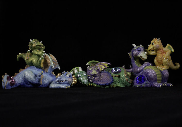 These are lightbox photographs of some mood dragons I own. Dragon Green Pink Statue Blue Lightbox Lightbox Photography Mama And Baby Dragons Mood Dragons