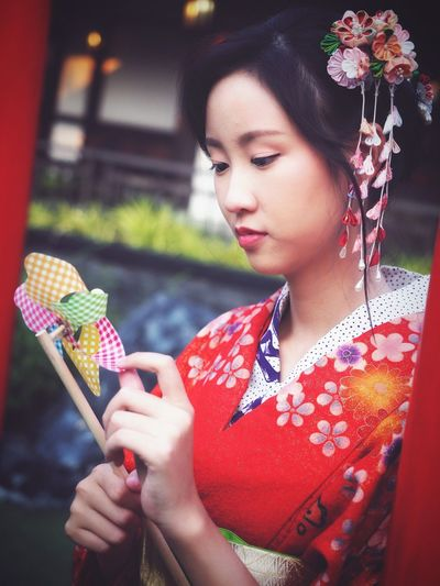 beautiful woman in red kimono Japanese Culture Japanese Style Kimono Dress Kanzashi Treditional Clothing Hair Pin Only Women Red Adult One Woman Only One Person Adults Only Women Beauty Young Adult People Beautiful People Beautiful Woman Portrait Young Women Fine Art Portrait Holding Outdoors