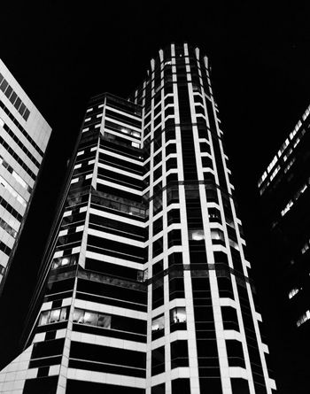 Blackandwhite Minimalism Architecture Low Angle View Architecture Building Exterior Skyscraper Built Structure Modern City Development Night Growth No People Outdoors Tall Corporate Business Illuminated Sky Visual Creativity The Architect - 2018 EyeEm Awards The Great Outdoors - 2018 EyeEm Awards The Traveler - 2018 EyeEm Awards