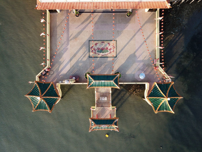 High angle view of decoration hanging on tiled floor