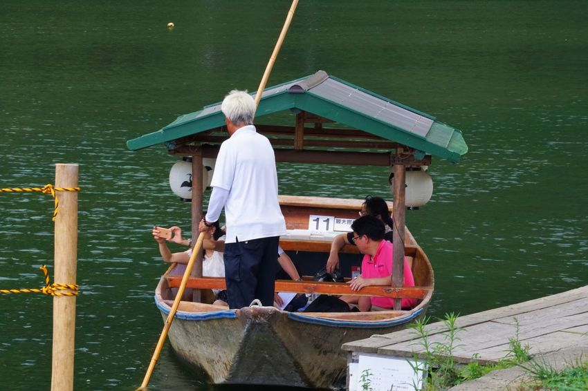 Traditional Transportation Traditional Culture Travel Destinations Water Nautical Vessel Real People Transportation Standing Men Leisure Activity Boat Mode Of Transport Lake Lifestyles Nature Vacations