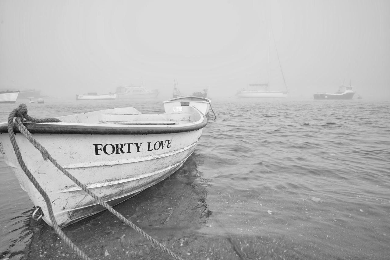 nautical vessel, transportation, boat, mode of transport, moored, sea, water, text, beach, communication, outdoors, no people, sailing, harbor, day, nature, sky