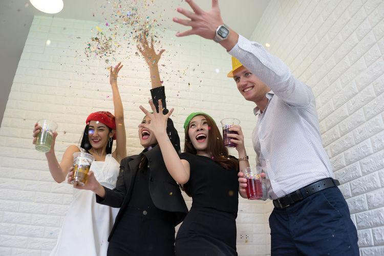 Friends Enjoying Party Against Brick Wall