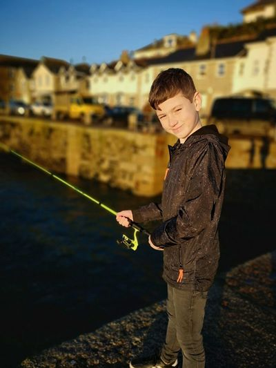 fishing in the harbour Portrait Selective Focus Aperture Portrait Of A Boy Fishing Cornish Life Young Boy Fishing Family Time Smiling Portrait Standing Water Fashion Holding Sky Fishing Rod Fishing Equipment