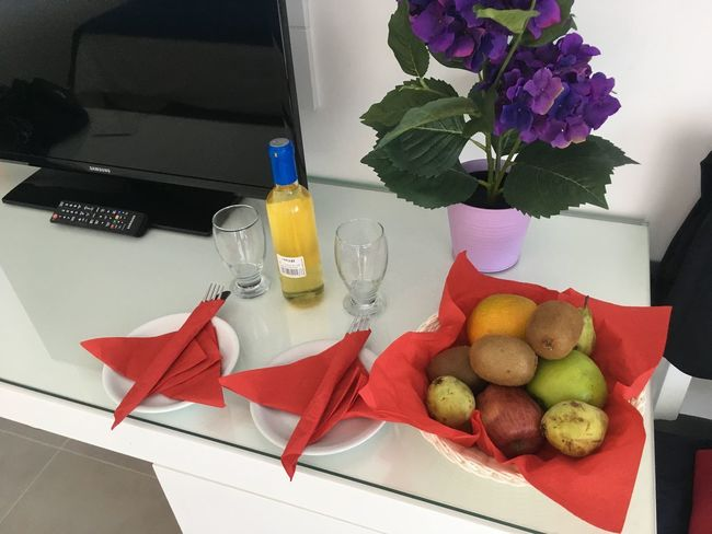 Arrangement Close-up Day Drink Drinking Glass Flower Food Food And Drink Freshness Fruit Indoors  Leaf Napkin No People Place Setting Table Vase Water Wineglass