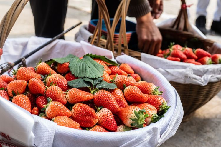 Close-up of strawberries in baskets at market