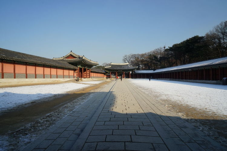 Changduk Palace Korean Traditional Architecture UNESCO World Heritage Site Winter Architecture Building Exterior Built Structure Clear Sky Day Nature Outdoors Seoul City Sky Snow Travel Destinations Tree