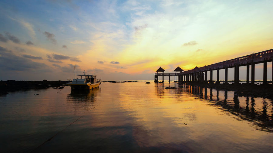 Asian  Gold Beach Boat Moored Sea And Sky Seascape Sunrise