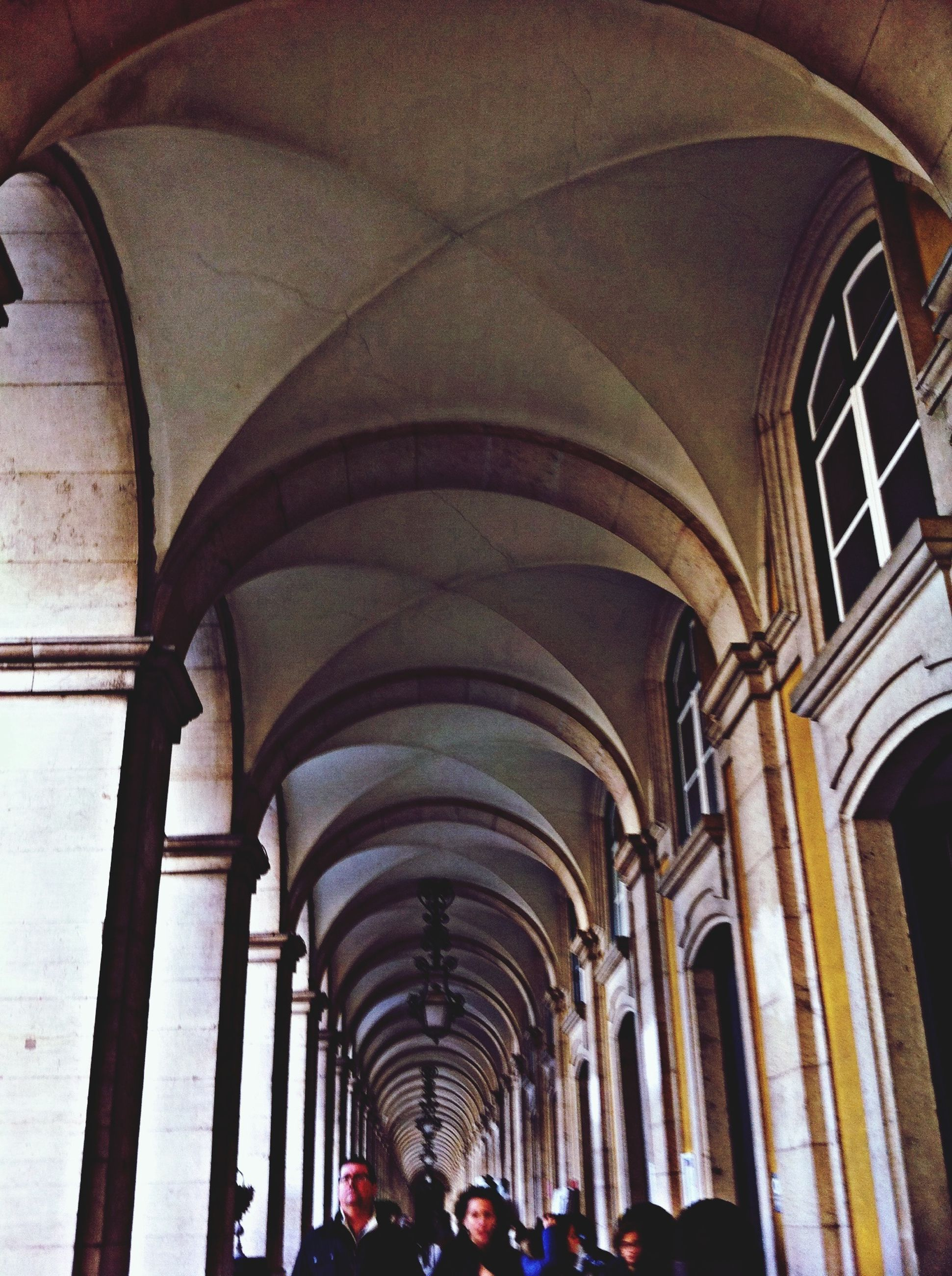 arch, indoors, architecture, built structure, person, ceiling, men, architectural column, lifestyles, large group of people, archway, travel, tourist, leisure activity, walking, arched, history, incidental people, illuminated