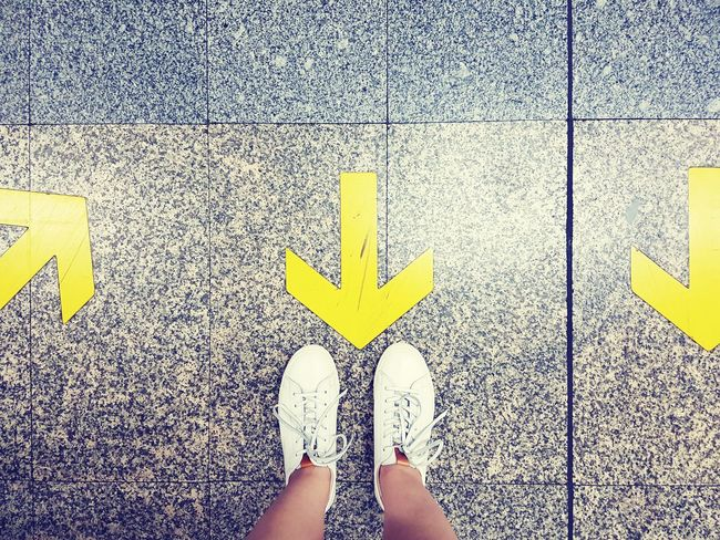 Yellow Arrow Symbol Guidance Communication Day People Walkway Vintage Chill Mode Sneakers EyeEmNewHere The Week On EyeEm Personal Perspective White Shoes Ground Floor Journey Traveler Paint The Town Yellow