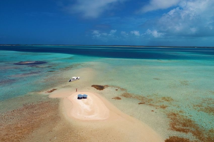Aerial view of island and beach in Los Roques, Venezuela Water Sea Sky Scenics - Nature Beach Land Beauty In Nature Tranquility Tranquil Scene Cloud - Sky Nature Day Horizon Over Water Horizon Blue Idyllic Sand Outdoors No People Turquoise Colored Los Roques Madrisqui Caribe Caribbean Caribbean Life Caribbean Island Francisqui Crasqui Carenero's Beach Cayo De Agua Venezuela
