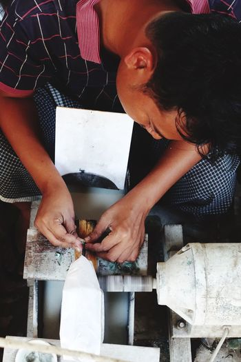 High angle view of manual worker working in factory