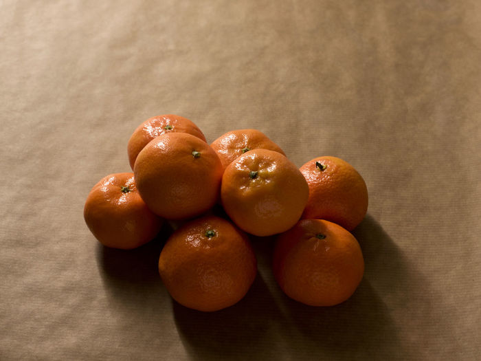 Citrus  Freshness Brown Brown Paper Citrus Fruit Clementine Clementines Food Fruit Healthy Healthy Eating Healthy Food Ingredient Light And Shadow Mandarins Minimal Minimalism Monochromatic Monochrome Mood Obst Orange Color Peel Peeling Pile Still Life