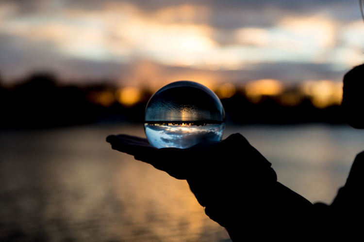 turnarround Beauty In Nature Crystal Ball Holding Human Body Part Human Hand Nature One Person Outdoors Reflection Scenics Silhouette Sky Sunset Water