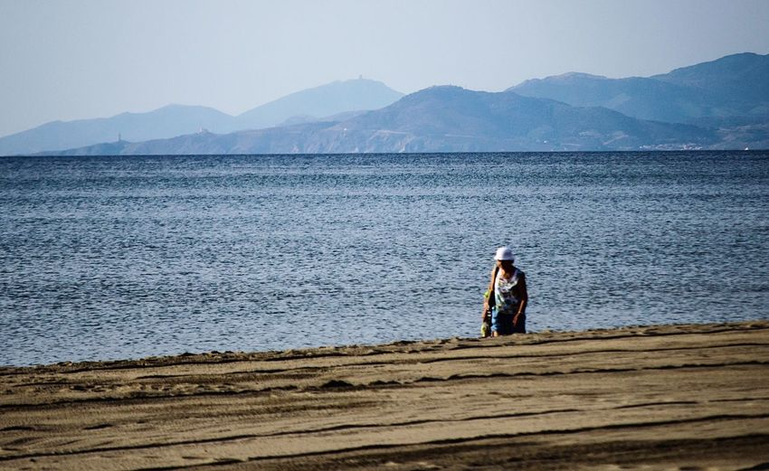 Lonely walk, incognito The Queen Queen Alone Walking Alone... Beach Mountains Sea Ocean Ocean View Mountain Walking Old Lady Beachphotography