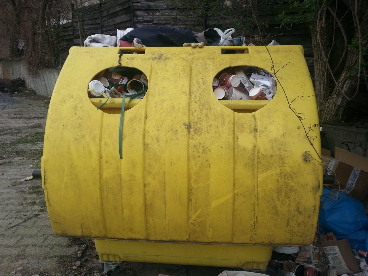 Yellow Dustbin Full Of Garbage
