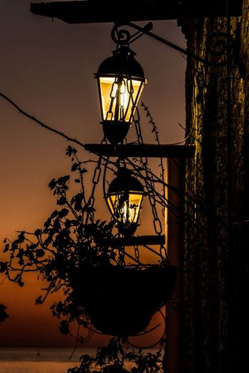 Capturing the last moments of the sunset Lighting Equipment Shadow No People Night Nature Built Structure Architecture Sky Low Angle View Illuminated Tree Plant Outdoors Wall - Building Feature Building Exterior Street Electric Lamp Sunset Light Silhouette