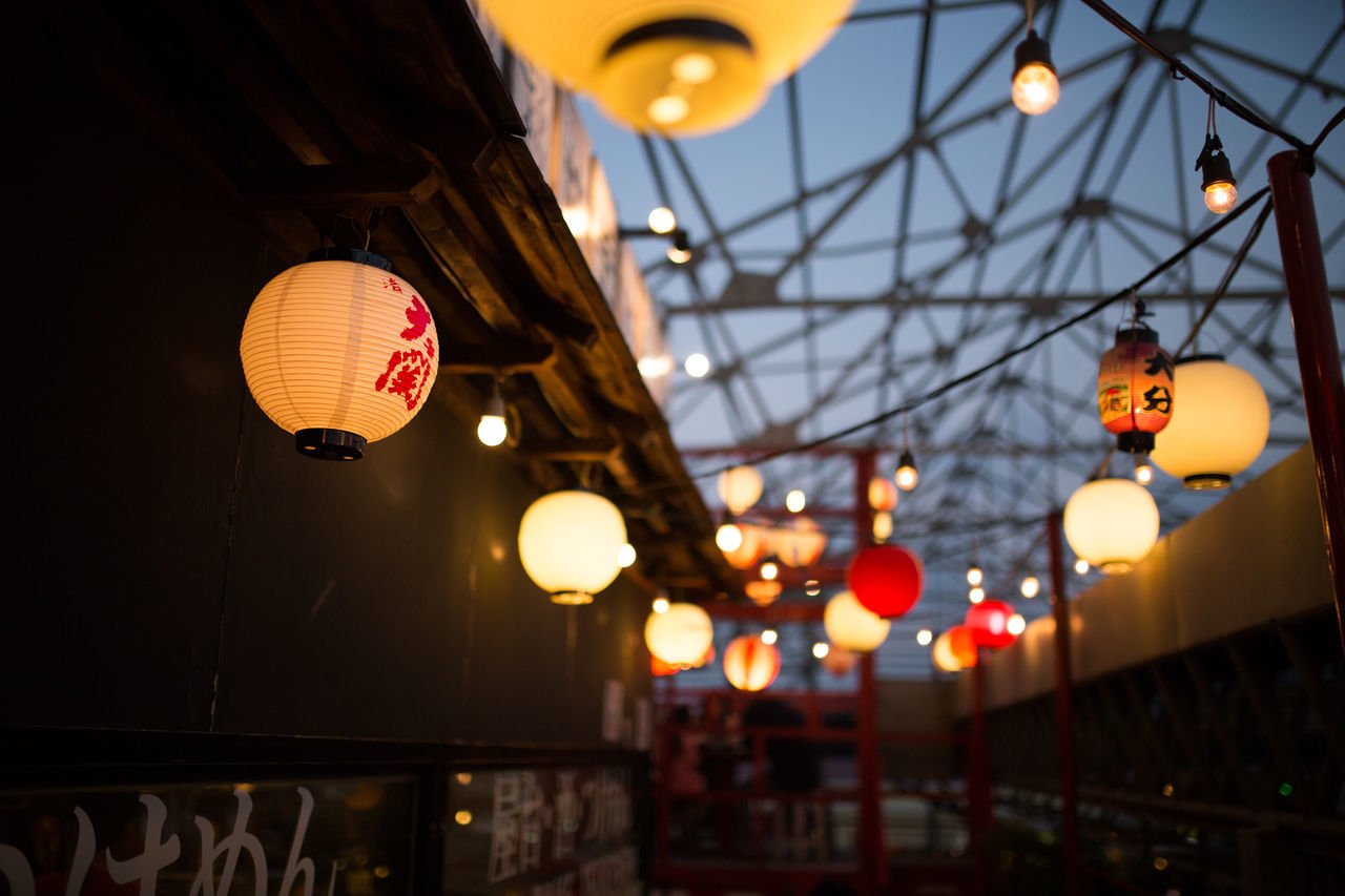 Illuminated Japanese Lanterns At City Street