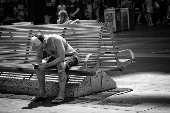 Full Length Outdoors One Person One Man Only Adult Young Adult Only Men People Watching Street Life City People Photography Black And White Street Photography Monochrome Real People Casual Clothing Melbourne City Sitting Seated Text Messaging Mobile Phone On The Phone Welcome To Black The City Light Spontaneous