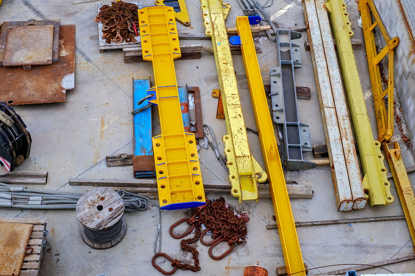 Construction area with crane girder elements Construction Site Steel Cable Architecture Beams And Girders Chains Crane - Bird Crane - Construction Machinery Day Girders Iron Rusting No People Outdoors Yellow