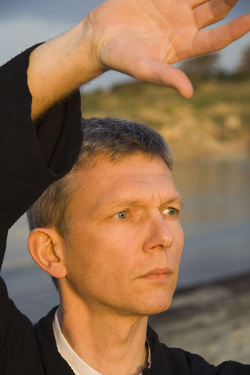 Close-up of man practicing tai chi at beach