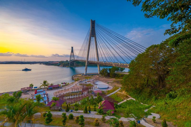 Wonderful bridge view with amazing light of sunrise. This photo take in the one of beautiful place Batam island Indonesia. Landscape Nature Background Wonderful Indonesia Wonderful Place Sunrise_sunsets_aroundworld Sunrise Sky Plant Nature Architecture Tree Water Built Structure Amusement Park Arts Culture And Entertainment Amusement Park Ride Sunset Beauty In Nature Outdoors Cloud - Sky Transportation No People Scenics - Nature Day Connection