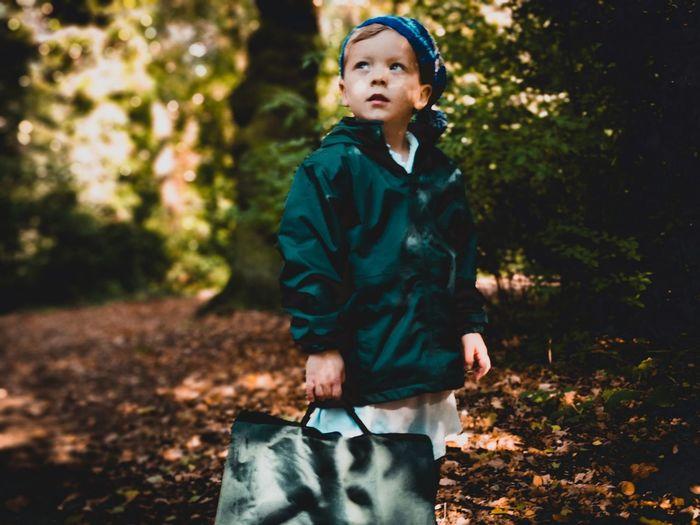 Full length of boy in forest