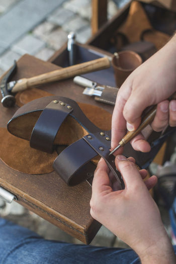 Shoes Shoemaker Craft Leather Hands Handmade Work Tools Human Hand Hand One Person Occupation Art And Craft Skill  Real People Human Body Part Working Workshop Craftsperson Holding Work Tool Indoors  Accuracy Creativity Workbench