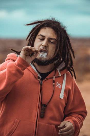 Mid adult man smoking cigarette