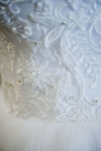 Backgrounds Celebration Celebration Event Close-up Clothing Dress Embroidery Event Floral Pattern Full Frame Indoors  Lace - Textile Laces Life Events No People Pattern Pearl Jewelry Selective Focus Textile Wedding Wedding Dress White White Color White Lace
