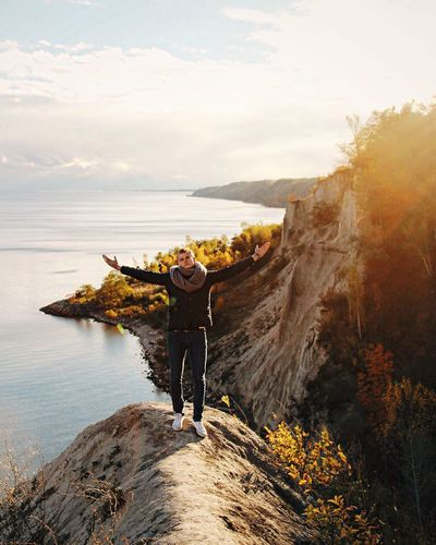 Adventure Beauty In Nature Boy Day Leisure Activity Lifestyles Mountain Nature One Person Outdoors Park Positive Real People Rear View Rock - Object Sky Standing Sunset Sunshine Travel Travel Destinations Yellow Young Adult