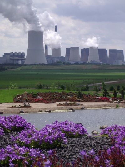 View of steaming cooling towers at nuclear power plant