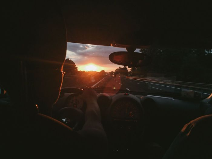 Road Trip Lens Flare Sun Window Steering Wheel Driving Travel Indoors  Nature Transparent Windshield Sunset Car Interior Sky Real People Glass - Material Vehicle Interior Land Vehicle Mode Of Transportation Transportation Motor Vehicle Car Be. Ready. Indoors
