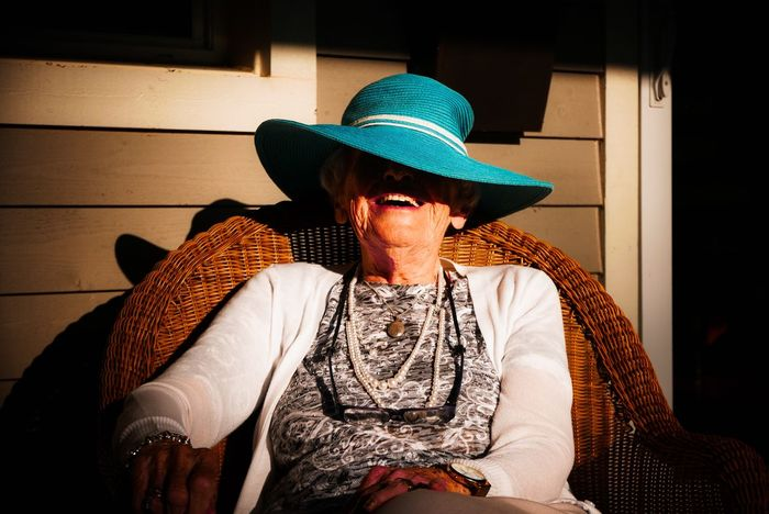 Life's good Senior Smiling Smiling Face Laughing Senior Women Lifestyle Sunlight Big Hat Woman Portrait Hat Front View Sombrero Sitting Outdoors One Person Sun Hat Real People Day Portrait Adult Headwear This Is Aging