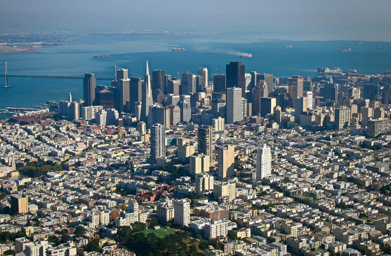Flying USA San Francisco Downtown San Francisco From Air Aerial View Architecture Bay Bridge Building Exterior Built Structure City Cityscape Crowded Day High Angle View Horizon Over Water Modern Outdoors Sea Sky Skyscraper Tall Transamerica Building Travel Destinations Water